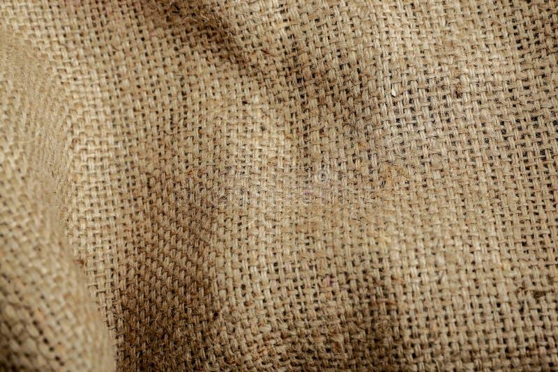 Sack-Beschaffenheits-Hintergrund Brown, gesponnen, Nahaufnahme lizenzfreie stockbilder