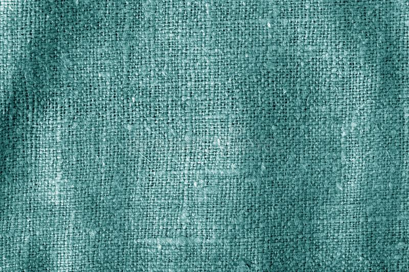 Sack cloth texture with blur effect in cyan color royalty free stock images
