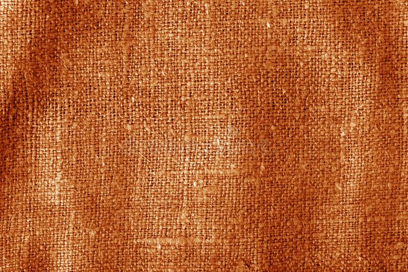 Sack cloth texture with blur effect in orange color royalty free stock images