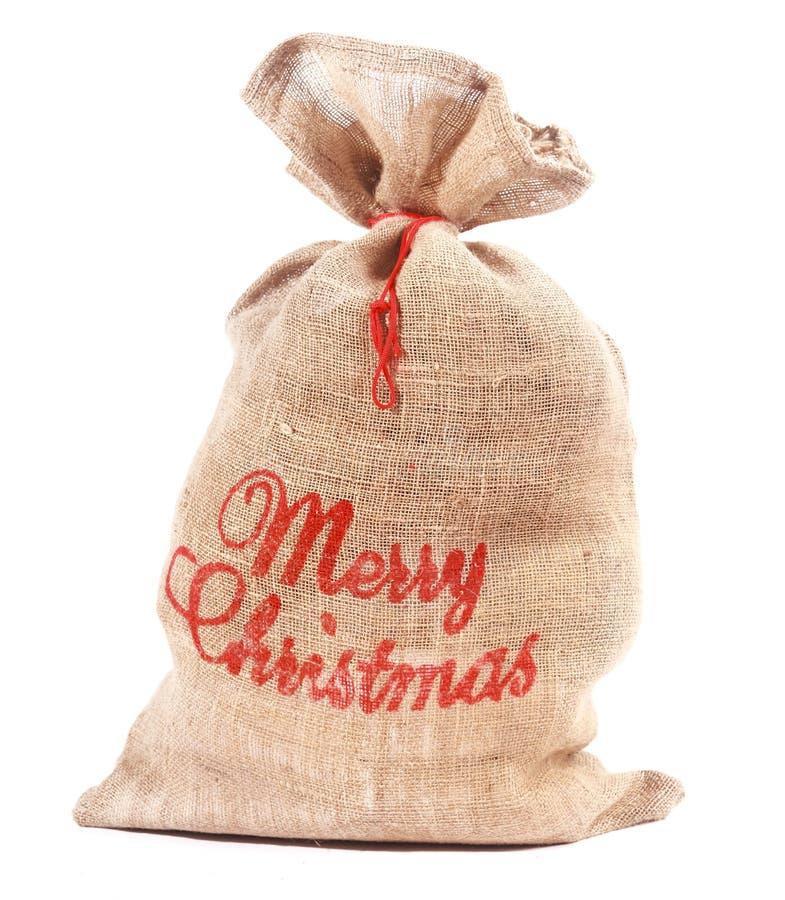 Sack der frohen Weihnachten voll Geschenke stockfotografie
