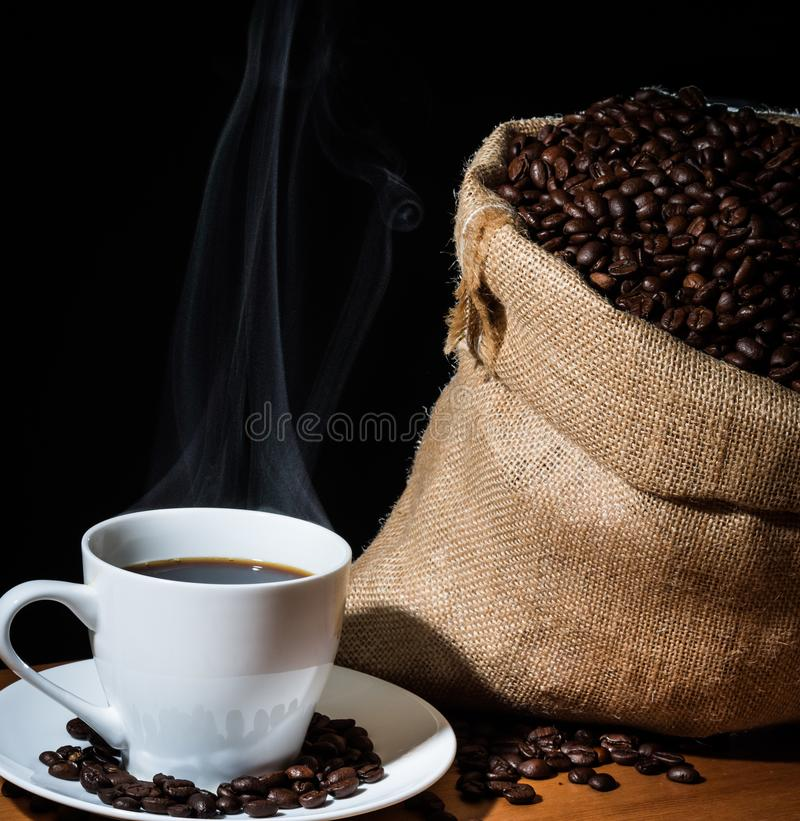 White Cup Of Brewed Coffee With Steam Or Vapor And