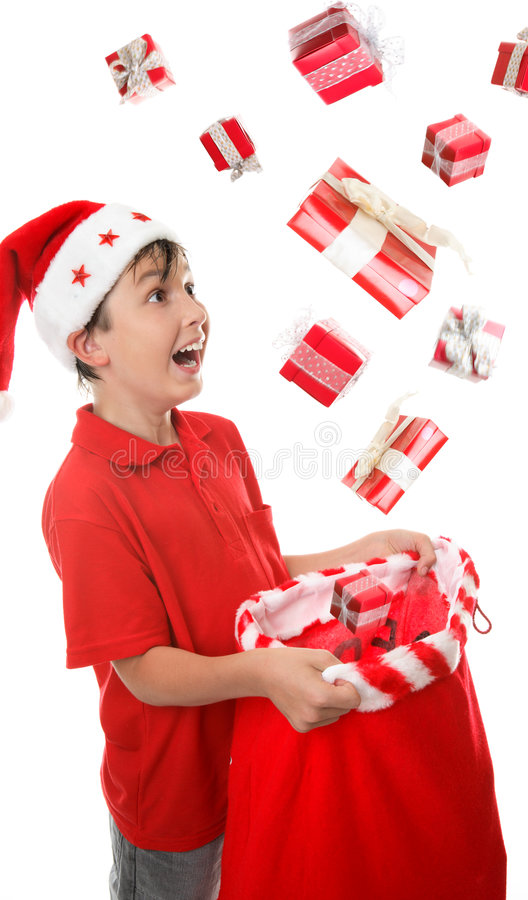Sack full of presents. Lots of presents fall into a young boys Christmas sack to his delight. Some motion visible in presents stock photo
