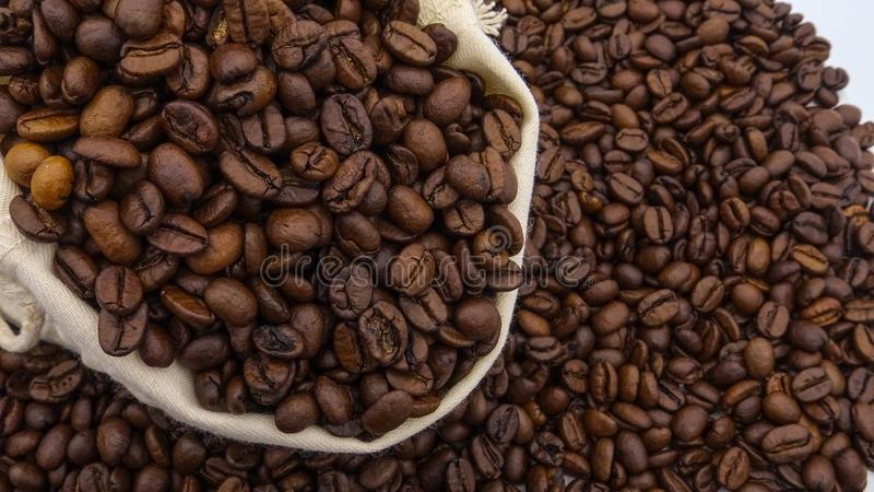 A sack with roasted coffee beans royalty free stock image