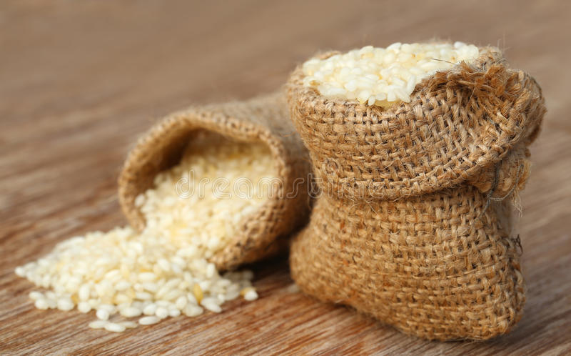 Sack with scattered rice royalty free stock image
