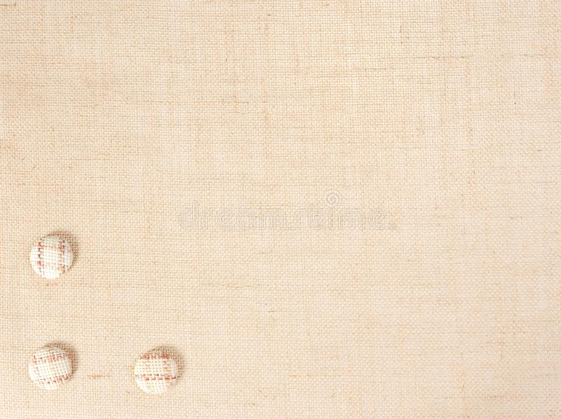 Sackcloth υπόβαθρο σύστασης υφάσματος και διακόσμηση κουμπιών, Burlap ύφασμα σάκων στοκ φωτογραφία