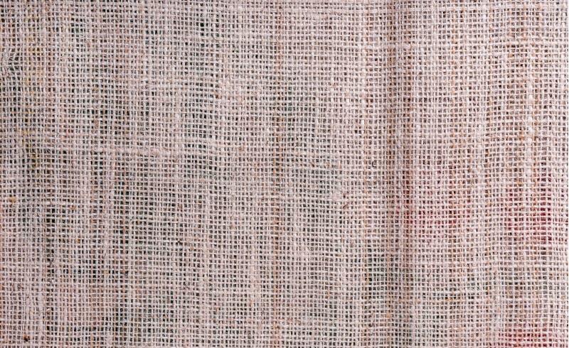 Sackcloth υφάσματος burlap καφετί υπόβαθρο χρώματος κρέμας στοκ φωτογραφία με δικαίωμα ελεύθερης χρήσης
