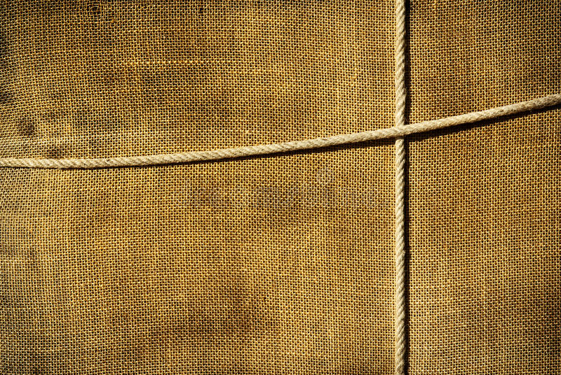 Sackcloth background. Background of sackcloth wrap tied up with ropes royalty free stock image