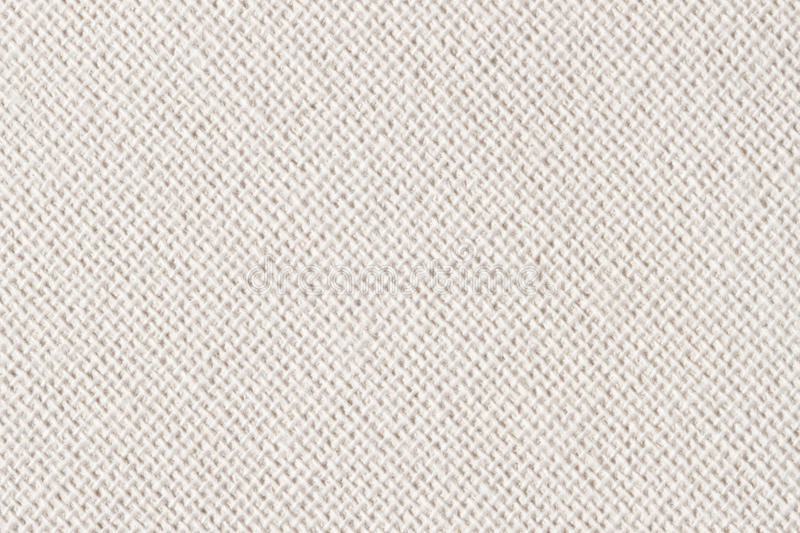 Sackcloth, canvas, fabric, jute, texture pattern for background. Cream soft color. Large diagonal stock image