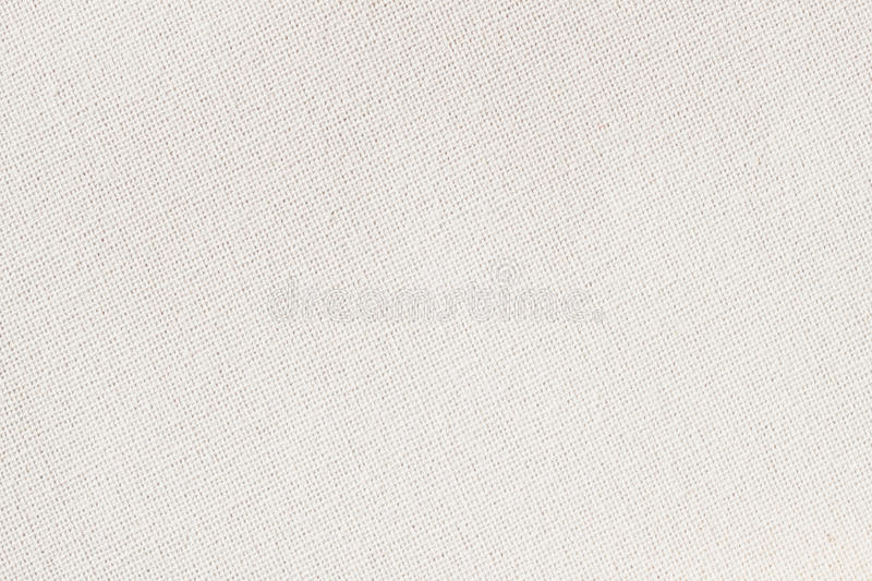 Sackcloth, canvas, fabric, jute, texture pattern for background. Cream soft color. Small diagonal stock photography