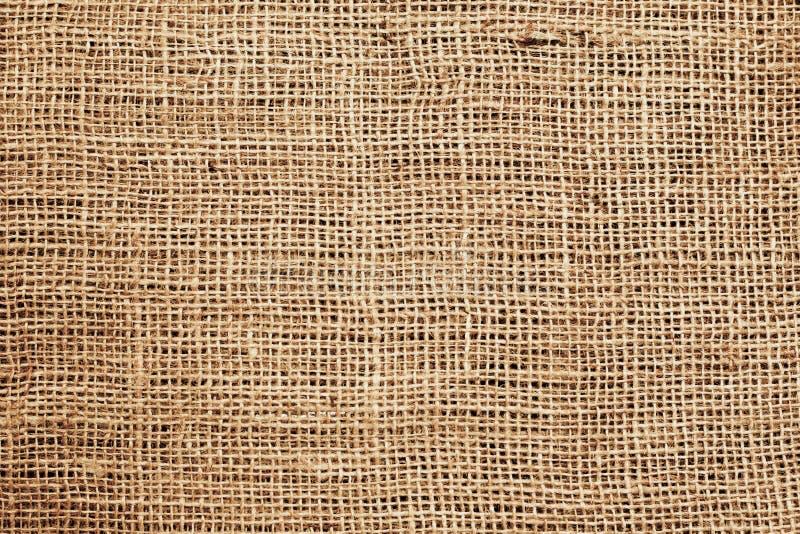 Sackcloth- eller burlap- eller plundrabakgrund. arkivfoton