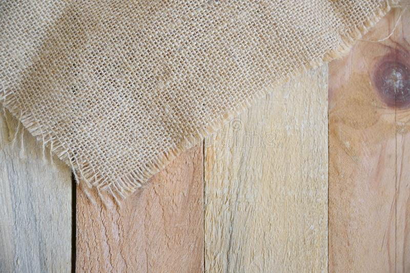 Sackcloth on a natural wooden table in a rustic kitchen. royalty free stock photos