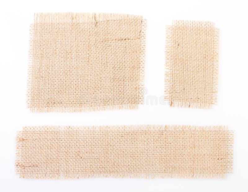 Sackcloth set tags over white. burlap. stock photo