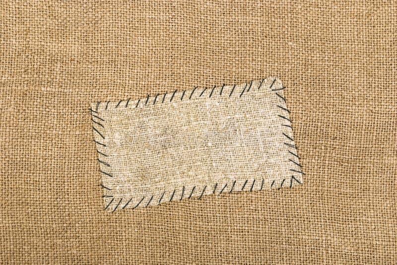 Sackcloth tag. On sackcloth material royalty free stock image