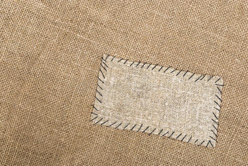 Sackcloth tag. On sackcloth material stock photo