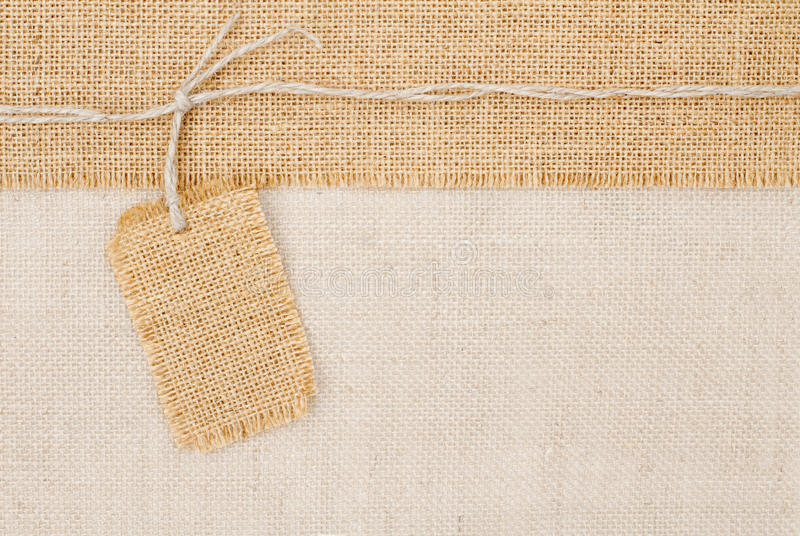 Sackcloth tag pricing. Over burlap texture. Copy space royalty free stock photo