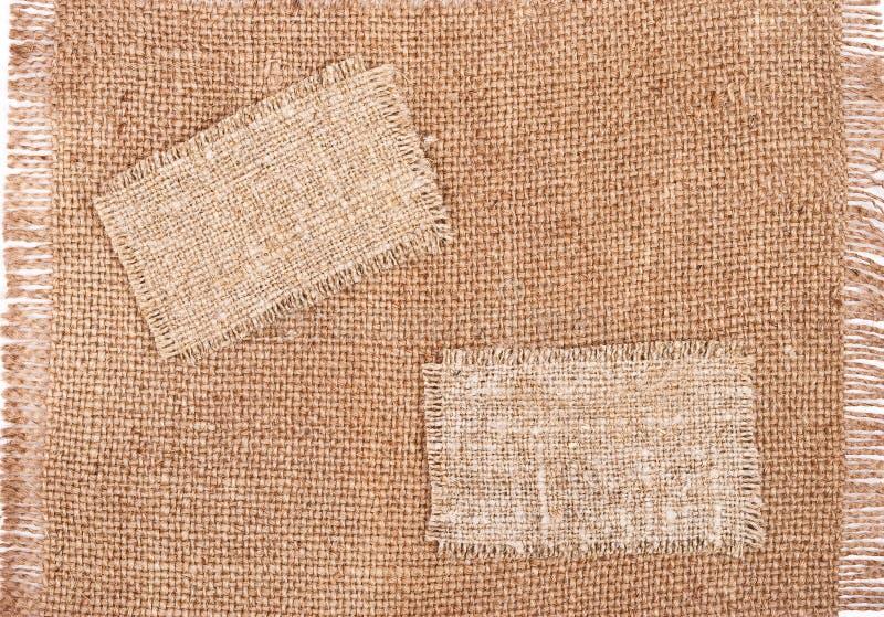 Sackcloth tags on sackcloth material royalty free stock image