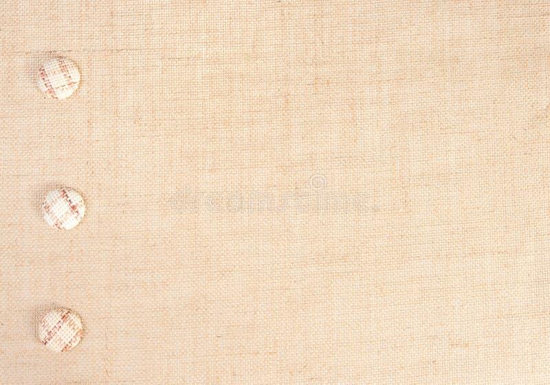 Sackleinen-Gewebe-Beschaffenheits-Hintergrund und Knopf-Dekoration, Leinwand-Sack-Stoff lizenzfreies stockbild