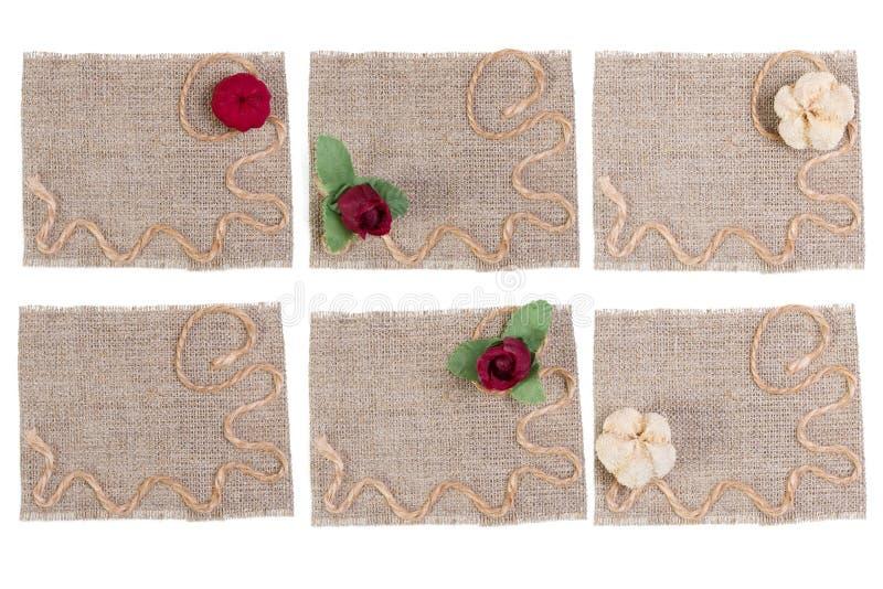 Sackleinen-und Blumen-Dekoration, Leinwand-Gewebe-Aufkleber-Flecken-Satz, rustikales Sack-Stoff-Stück lizenzfreie stockfotos