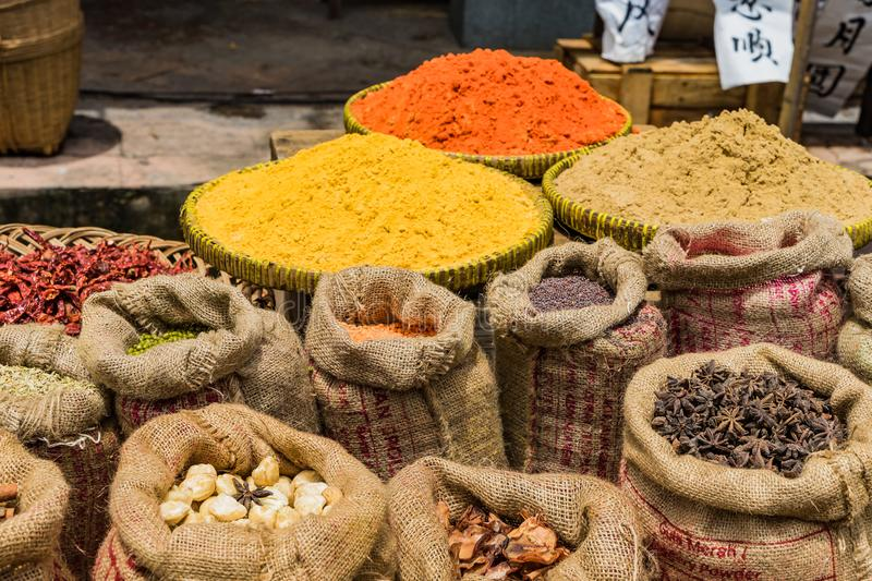 Sacks of Chinese herbs in the market. Beans, nuts, grains and curry powers royalty free stock photo
