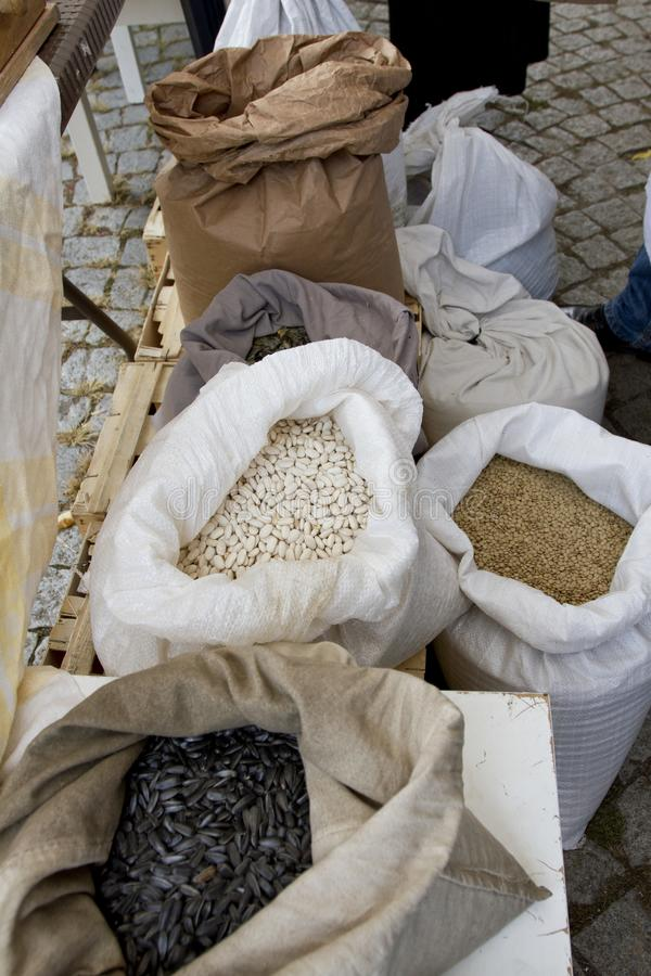 Sacks full with chickpeas, beans, buckwheat, millet, wheat, spelled, lentils, Einkorn wheat grains. Variety of beans, grains and s royalty free stock photos
