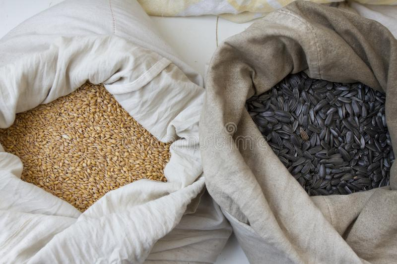 Sacks full with chickpeas, beans, buckwheat, millet, wheat, spelled, lentils, Einkorn wheat grains. Variety of beans, grains and s royalty free stock image