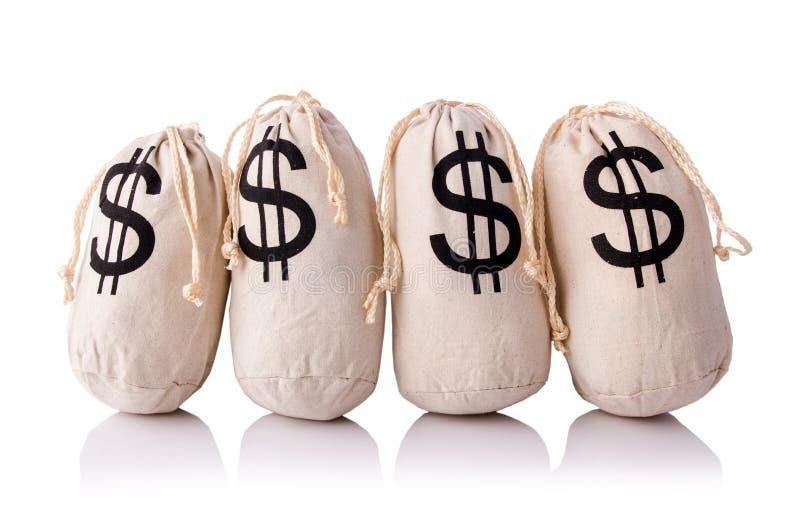 Sacks full of money. On the white royalty free stock photo