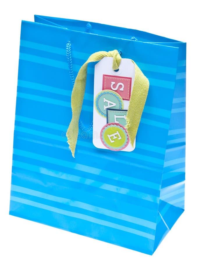 Saco colorido do presente ou de compra com Tag da venda fotografia de stock royalty free