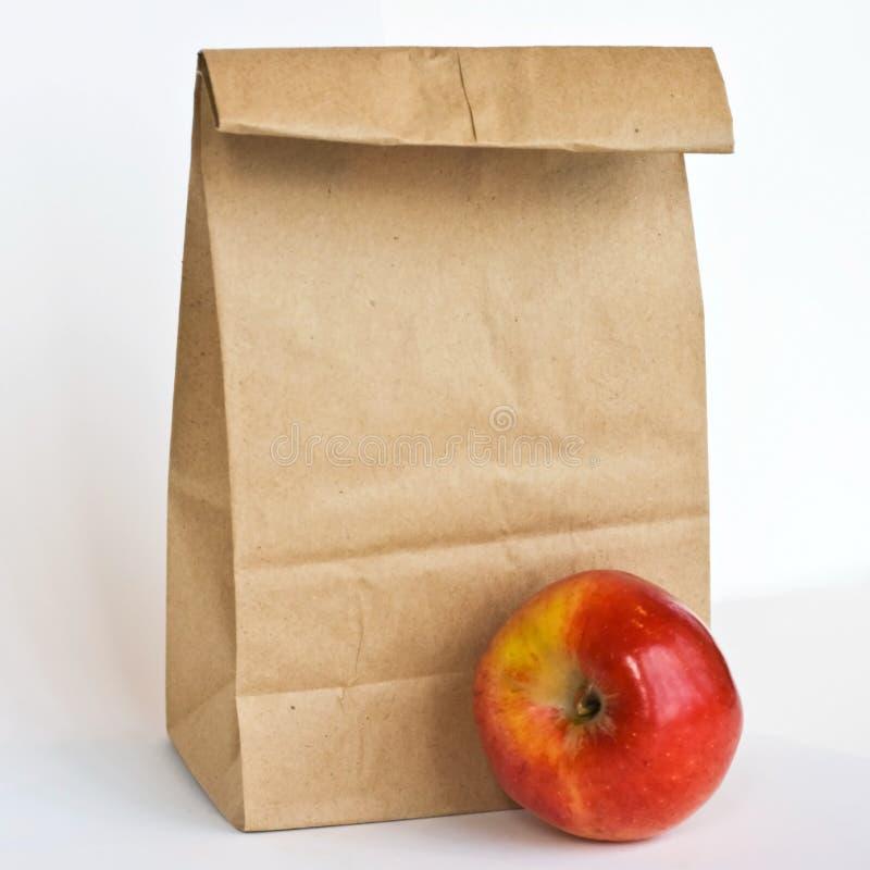 Saco de Brown e gala Apple imagem de stock