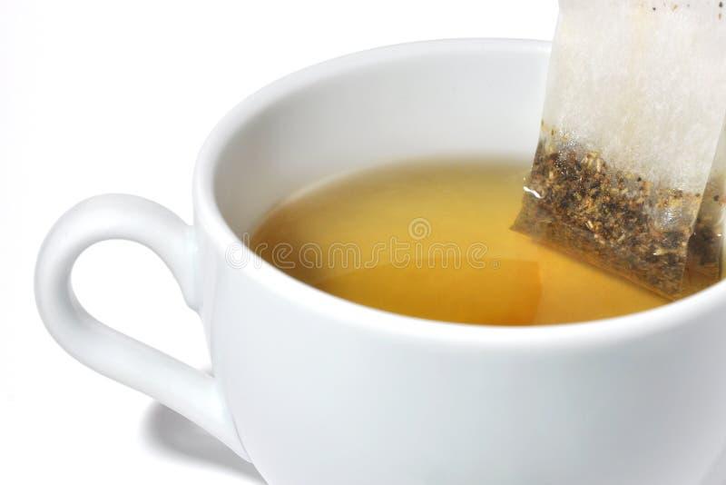 Saco de chá em um copo imagem de stock