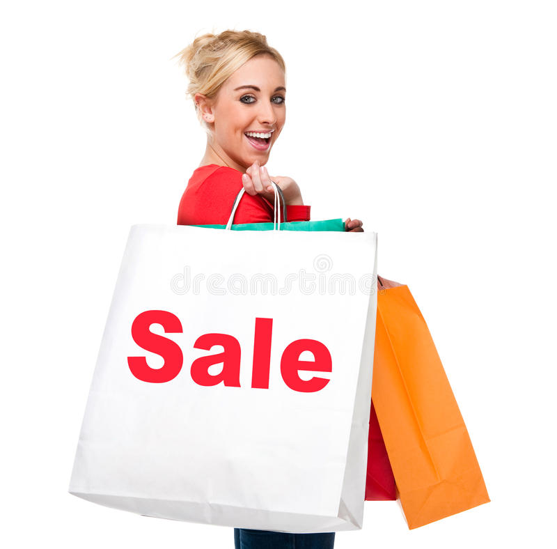 Saco de compra carreg bonito da venda da mulher nova foto de stock royalty free