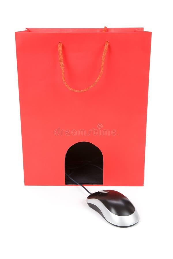 Saco de compra e rato do computador fotografia de stock