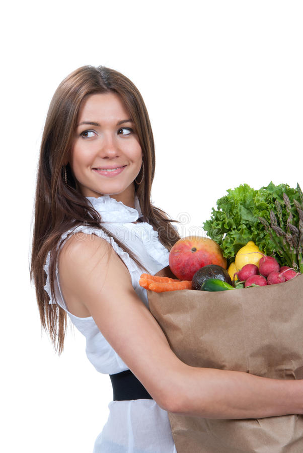 Saco de compras da mulher com vegetais dos mantimentos imagem de stock