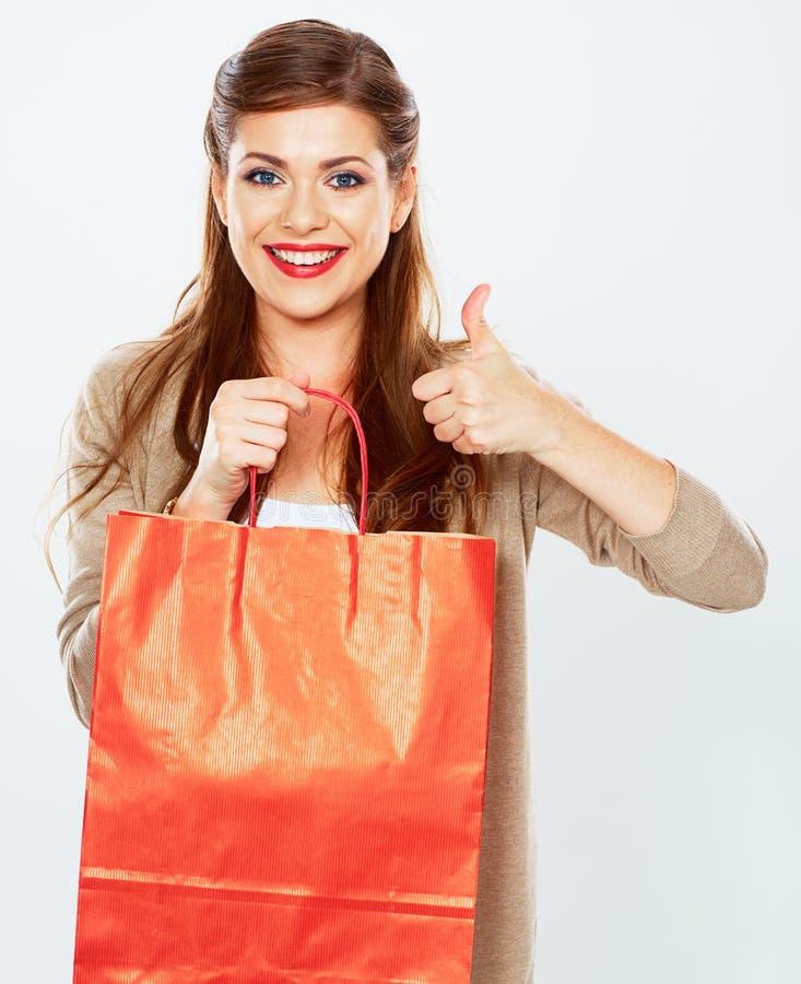 Saco de compras da posse da jovem mulher Polegar acima fotografia de stock