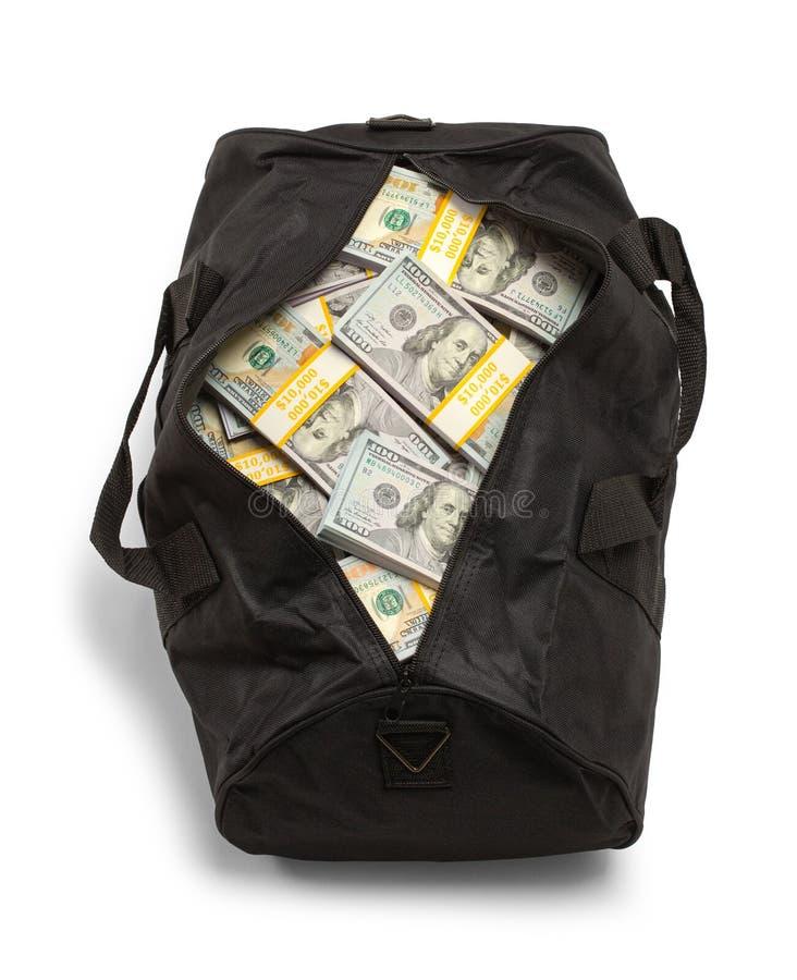 Saco de Duffel completamente da opinião superior do dinheiro imagem de stock royalty free