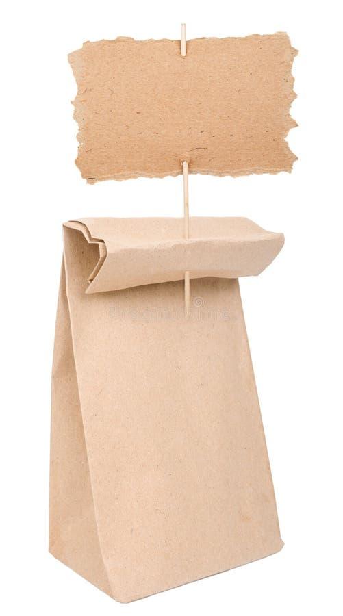 Saco de papel com sinal do cartão imagens de stock