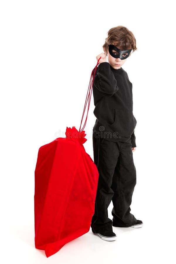 Saco de Santa do stealin da criança fotos de stock