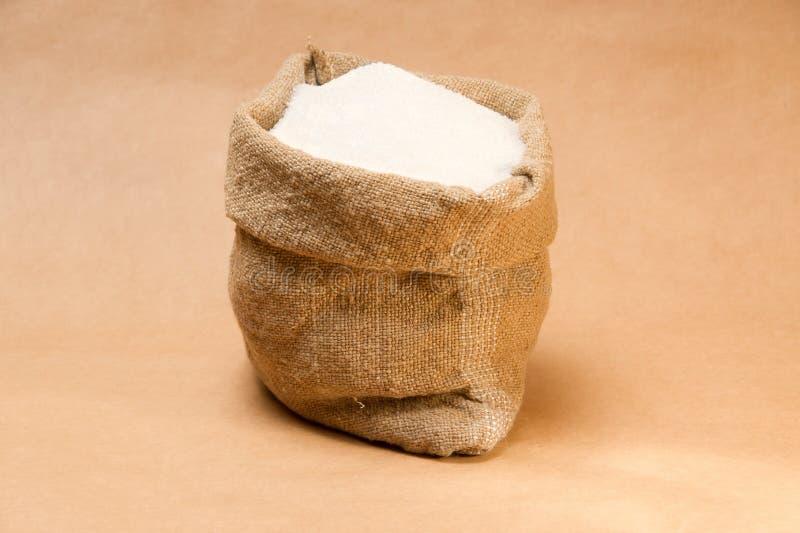 Saco del azúcar en el papel extrafuerte fotos de archivo