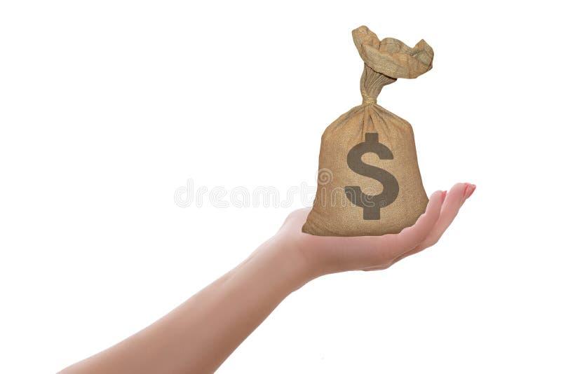 Saco fêmea da terra arrendada da mão do dinheiro do dólar isolado Conceito do pagamento ou do investimento financeiro, fotografia de stock
