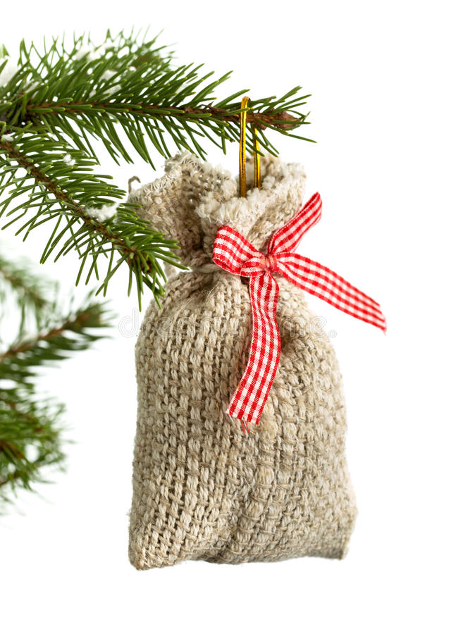 Saco pequeno do presente do Natal isolado no branco foto de stock royalty free