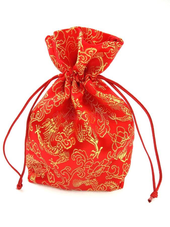 Saco vermelho de pano em um fundo branco fotografia de stock