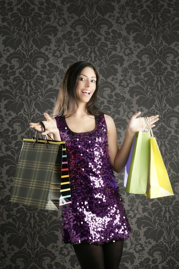 Sacos coloridos da mulher de Shopaholic retros fotografia de stock royalty free