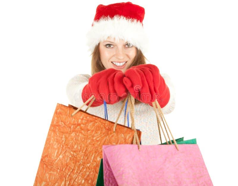Sacos de compra carreg da menina do Natal fotografia de stock