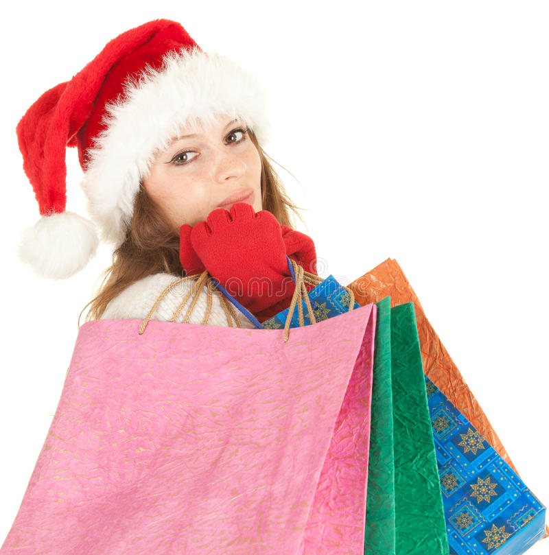 Sacos de compra carreg da menina do Natal imagens de stock royalty free