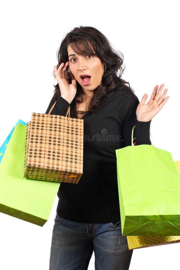 Sacos de compra da terra arrendada da mulher fotos de stock