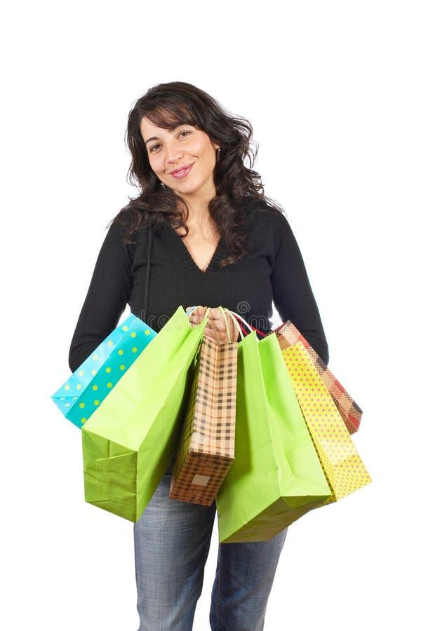 Sacos de compra da terra arrendada da mulher imagem de stock royalty free