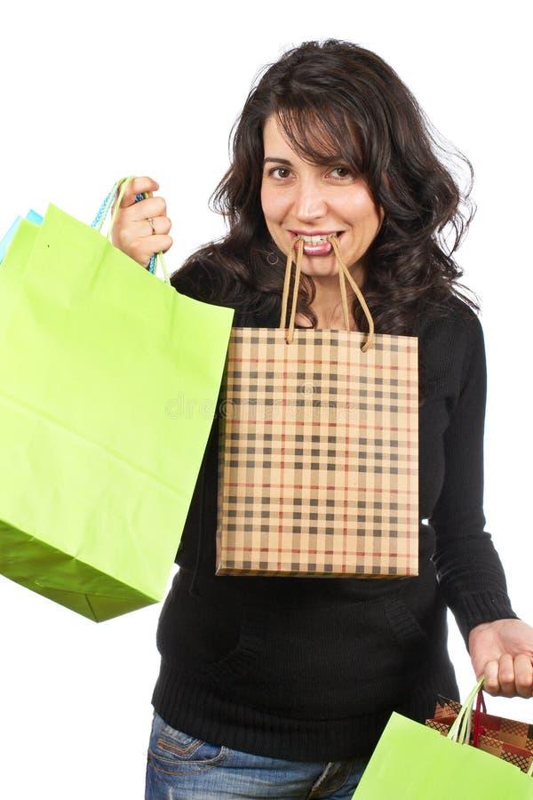 Sacos de compra da terra arrendada da mulher foto de stock
