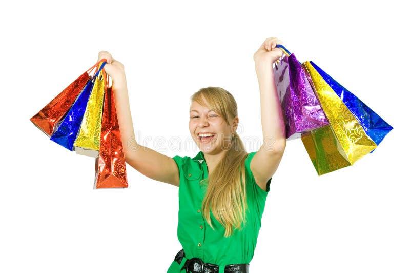 Sacos de compra felizes da terra arrendada da menina imagem de stock
