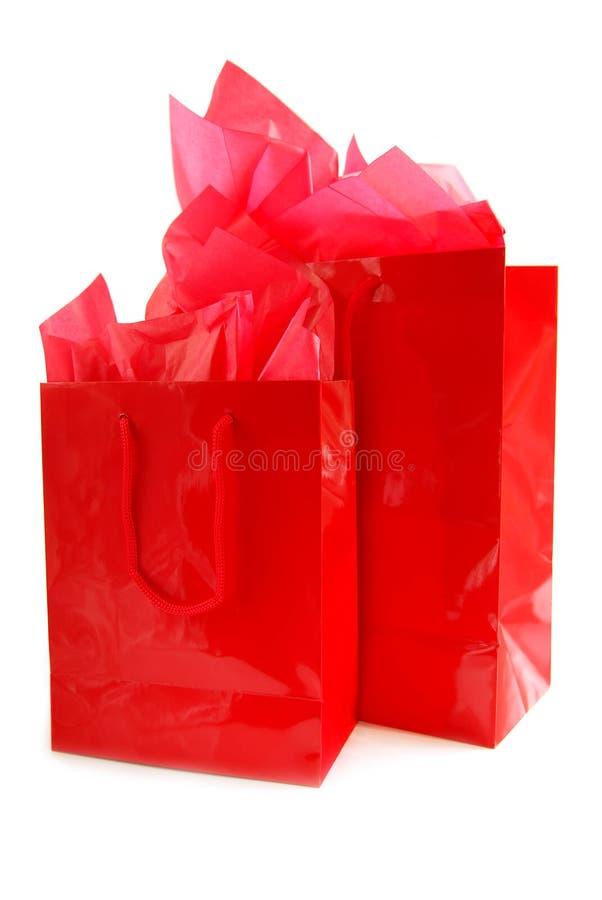 Sacos de compra vermelhos imagem de stock royalty free