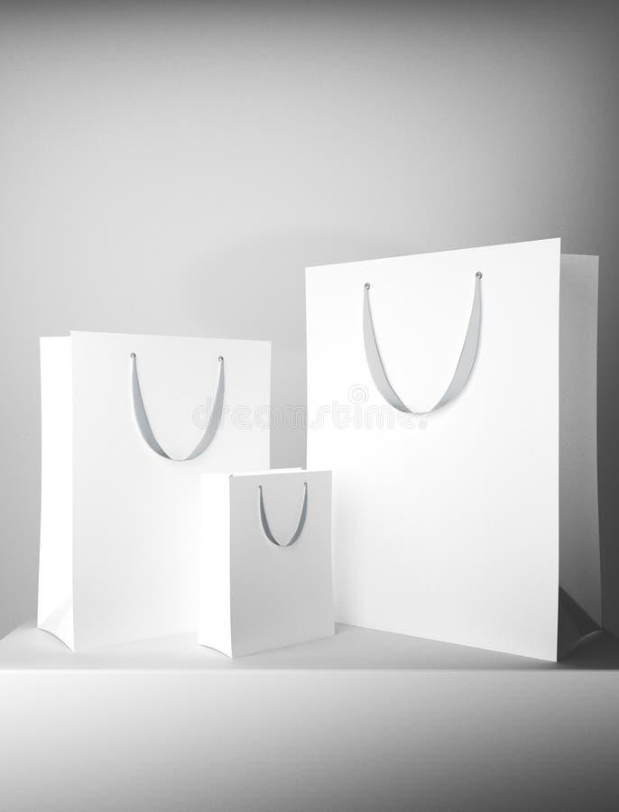 Sacos de compras brancos vazios ilustração stock