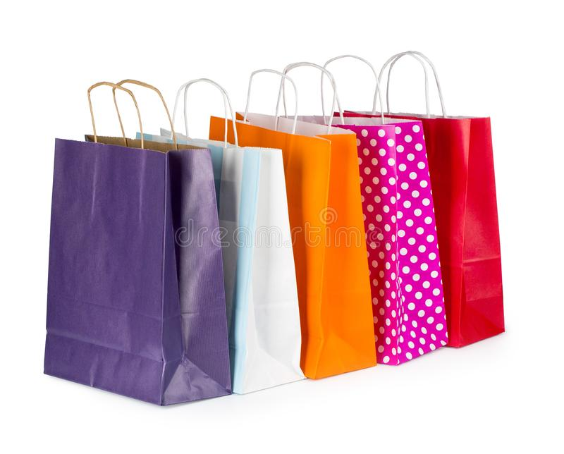 Sacos de compras de papel coloridos imagens de stock